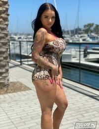 Curvy stunner Payton Preslee flaunting her thick orbs in a pinkish bikini