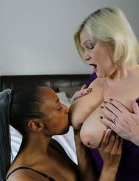 Kinky granny Lacey Starr licks jism off an ebonys ass in a hot IR three way