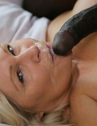 Plump granny Lacey Starlet feeds her facehole & vagina with a large captured meat pillar
