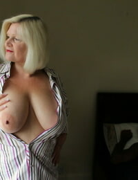 Gorgeous light-haired granny Lacey Starr gets blacked wearing undergarments