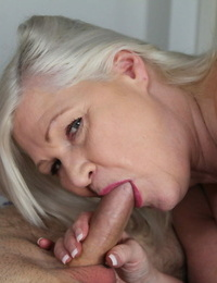 Fat granny Lacey Starr gives head and demonstrates her big naturals on a sofa