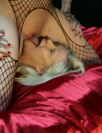 Bald-headed sapphic Hayley Hazard queening a sleazy granny in fishnets