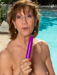 Slutty granny Demi strips bare & playthings her old cunt with a faux-cock by the pool