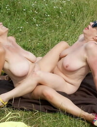 Old amateur Savana has lesbo hookup with a gf on a blanket in a field