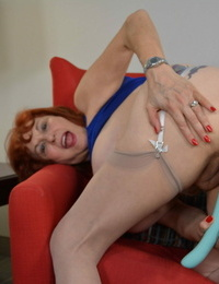 American mature woman toying with all of her fucktoys - part 394