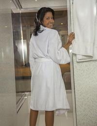 Latina teenage Carol Lopez peels off fondling pants on way to shower masturbation