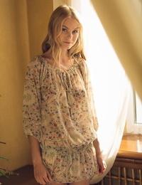 Lovely ash-blonde teen Nancy A slips off her floral dress to model bare