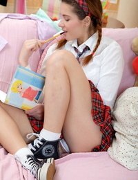 Lovely schoolgirl with her hair in ponytails playthings her asshole while masturbating