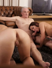 Teen girls ride on top of a couple of old men before sucking their peckers