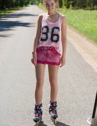 Young blonde chick Faina gets bare in middle of road wearing roller blades