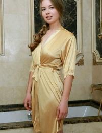 Stunning teen Camilla Stan sets her great assets free of satin bathrobe