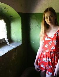 Tall teen Marika B strikes fine bare poses in front of seaside window