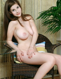 Beautiful babe Marta E waits for girlfriend and kills the time posing bare