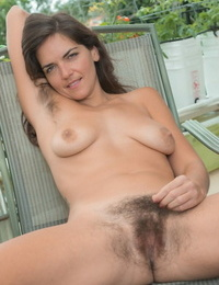 Wooly amateur Katie Z doffs cut-offs and subjugation to model bare on patio stool