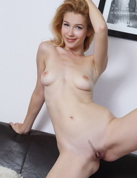 Light-haired solo girl Genevieve Gandi spreading trimmed cooter for glamour pics
