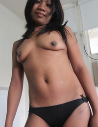 Petite Asian girl takes off on her bed for her nude modeling debut