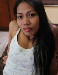 Filipina prostitute Analyn peels off naked on a motel couch for a hook-up tourist
