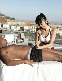 Japanese massagist Marica Hase seduces a black client during a rubdown