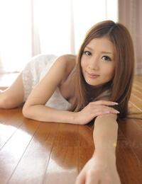 Beautiful Japanese lady Uta Kohaku lets a nipple slide in satin underwear