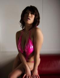 Japanese woman model lets a breast slip free while modeling swimwear
