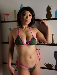 Japanese chick model lets a jug slide free while modeling swimwear