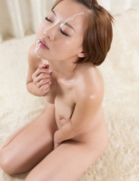 Nude Asian female sucks a cock on her knees prior to a facial jizz flow