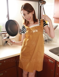 Adorable Japanese housewife Yui Saejima exposes her innate beaver in the kitchen