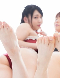 2 Japanese girls uses their lithe bare soles to wank off a dick