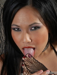 Scorching Asian model Nickey Milo gobbles her feet before cunt play in solo act