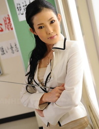 Scorching Japanese teacher Yui Komine uncovers her subjugation and bra in classroom