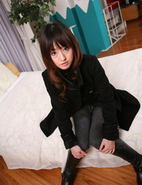 Japanese girl with a pretty face models non naked in a seized decorate and denim