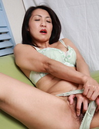 Japanese lady plunges her forearm down her underwear for solo flashing action