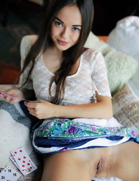 Gorgeous teen Li Moon uncovers her crazy tits while playing cards