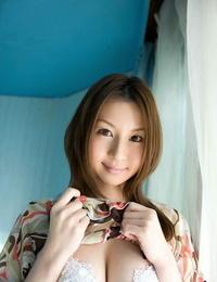 Young Japanese girl Tatsumi Yui hits great poses in crimson fondling OTK footwear