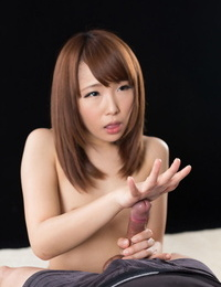 Fabulous lil\' Japanese girl on her kness opening up & giving a hot handjob
