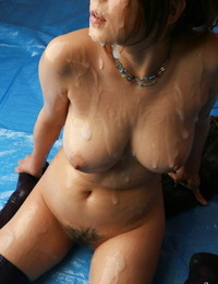 Japanese woman with lovely boobs and a trimmed bush is glazed in sperm