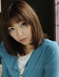 Japanese solo chick Juri Kitahara tentatively shows her hairless pussy