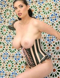 Molten Asian MILF pornstar Tera Patrick in heels licking her huge leaned