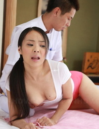 Japanese woman Ichika Aimi is greased up by massagist before being masturbated