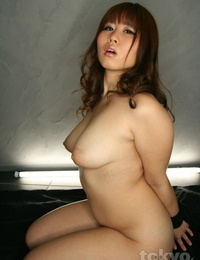 Round Asian girl with pointy tits receives a face screwing with her hands roped