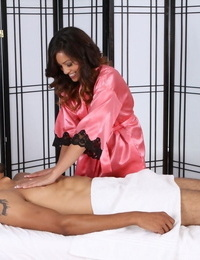 British masseur Alliyah Sky finishes off a massage in Sixty-nine stance