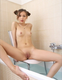 Asian solo woman shows off her small tits and hairless pussy in the bathroom bathtub