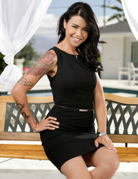 Tatted Asian doll Dana Vespoli beats sexy nude poses on a bench