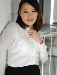 Asian chick Aki Sasahara is fitted with gag in white half-top and dark-hued skirt