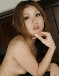 Erotic Japanese sweetie Hibiki Otsuki lounges naked with her flawless knockers naked