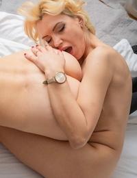Warm mature lesbians Milena & Midge Mayor undress before slurping pussies in sofa