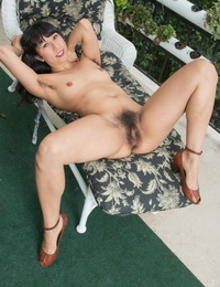 Solo girl Vivi Marie demonstrates her fur covered underarms and beaver on patio