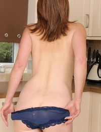 Mature housewife loses denim and undies to wank on the kitchen floor