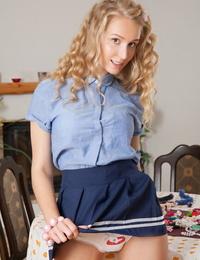Nice ten lady doffs her mini-skirt and underthings to pose bare in lengthy socks