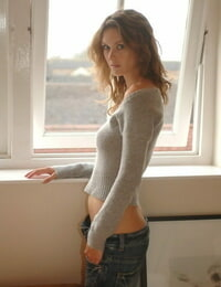 Solo girl Nikkala Stott takes off her sweater after having a abhorrent to eat